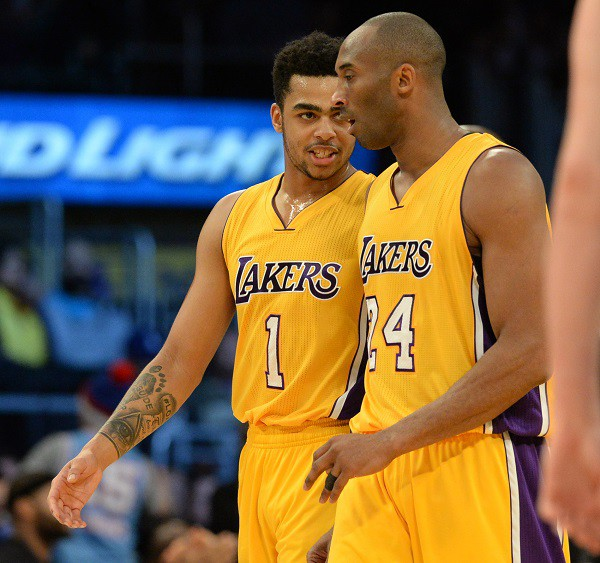 Los Angeles Lakers vs. Sacramento Kings Lakers' D'Angelo Russell (1) discusses a play with Kobe Bryant against the Kings during a NBA basketball game Wednesday, January 20, 2016, Staples Center, Los Angeles, CA. Photo by Steve McCrank/Staff Photographer