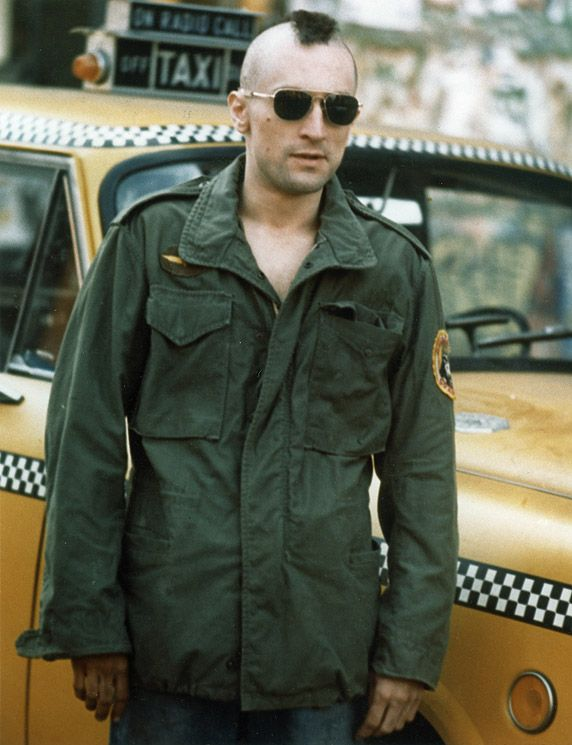 1976 --- American actor Robert de Niro on the set of Taxi Driver, directed by Martin Scorsese. --- Image by © Sunset Boulevard/Corbis